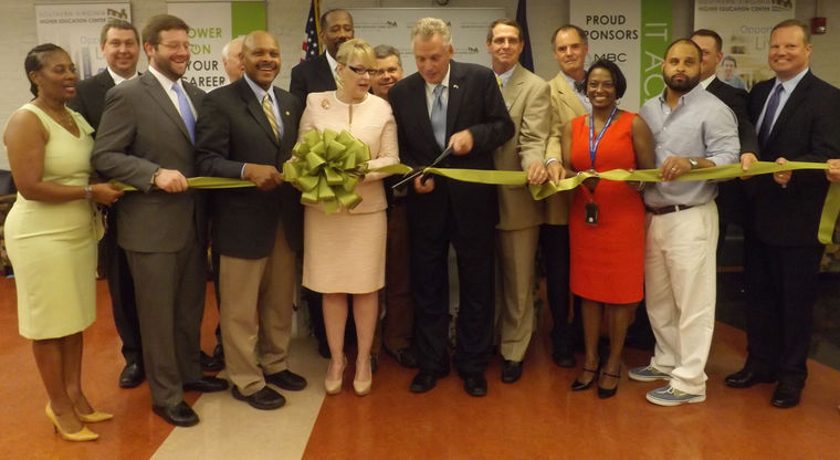 Alongside Southern Virginia Higher Education Center Executive Director Dr. Betty H. Adams and other distinguished guests, Governor Terry McAuliffe cuts the ribbon symbolizing the opening of the higher ed center's IT Academy. Courses will begin in August.